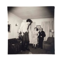 A Jewish giant at home with his parents in the Bronx, N.Y., 1970